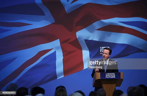 David Cameron UK prime minister and leader of the Conservative Party speaks as he unveils the party's 2015 general election manifesto in Swindon UK...