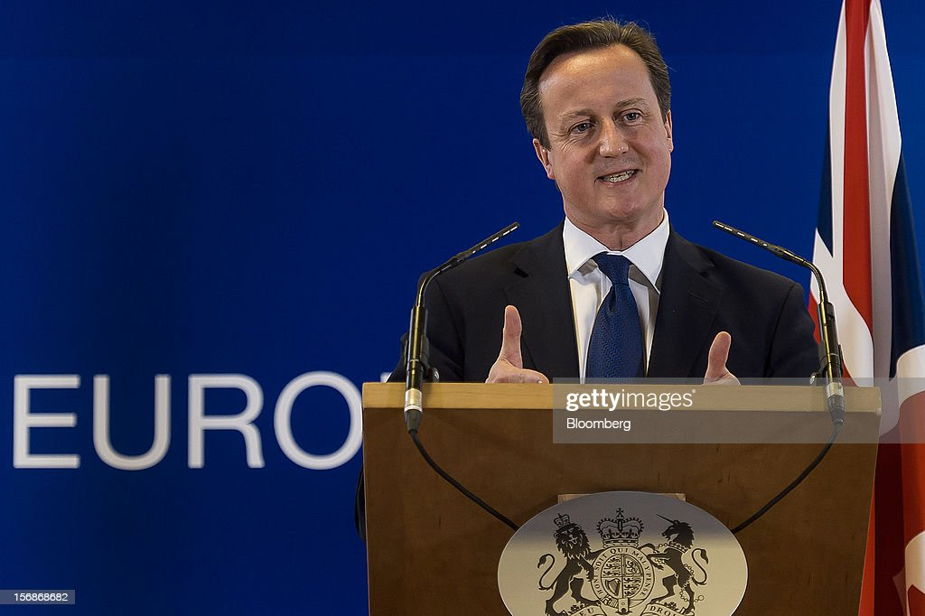 David Cameron, U.K. prime minister, gesture while speaking at a news conference following the European Union (EU) leaders summit meeting at the European Council headquarters in Brussels, Belgium, on Friday, Nov. 23, 2012. European Union leaders deadlocked over the bloc's next seven-year budget, adding to the quarrels between rich and poor countries that have stymied the response to the euro debt crisis. Photographer: Jock Fistick/Bloomberg via Getty Images