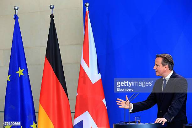 David Cameron UK prime minister gestures as he speaks during a news conference at the Chancellery in Berlin Germany on Friday May 29 2015 Chancellor...