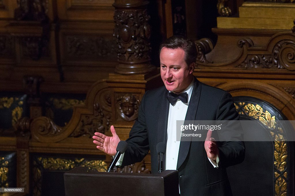 David Cameron, U.K. prime minister, gestures as he speaks during the annual Matthiae-Mahlzeit dinner at Hamburg's city hall in Hamburg, Germany, on Friday, Feb. 12, 2016. Cameron held talks with Angela Merkel, Germany's chancellor, as part of a push to secure new European Union membership terms that he can put to U.K. voters. Photographer: Krisztian Bocsi/Bloomberg via Getty Images