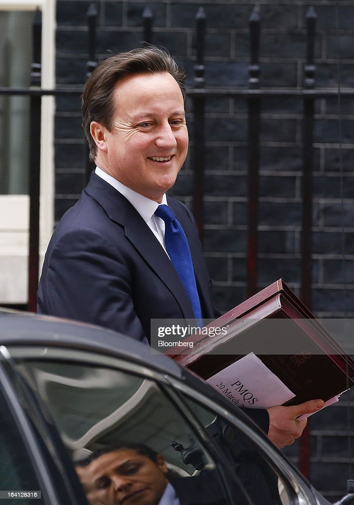 <a gi-track='captionPersonalityLinkClicked' href=/galleries/search?phrase=David+Cameron+-+Politician&family=editorial&specificpeople=227076 ng-click='$event.stopPropagation()'>David Cameron</a>, U.K. prime minister, leaves Downing Street ahead of the annual spring budget announcement in London, U.K., on Wednesday, March 20, 2013. Chancellor of the Exchequer George Osborne promised another austere budget as calls to stimulate the U.K. economy became more muted, easing political pressure on the government. Photographer: Jason Alden/Bloomberg via Getty Images