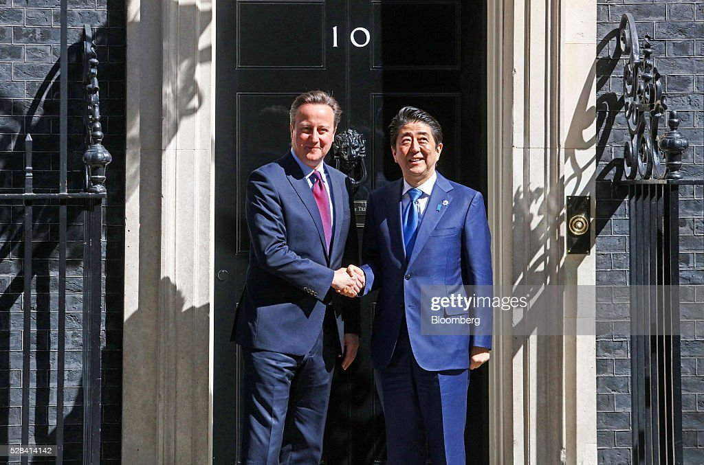 David Cameron, U.K. prime minister, left, shakes hands with Shinzo Abe, Japan's prime minister, outside number 10 Downing Street in London, U.K., on Thursday, May 5, 2016. Abe is due to discuss Japanese-European relations at a news conference. Photographer: Simon Dawson/Bloomberg via Getty Images