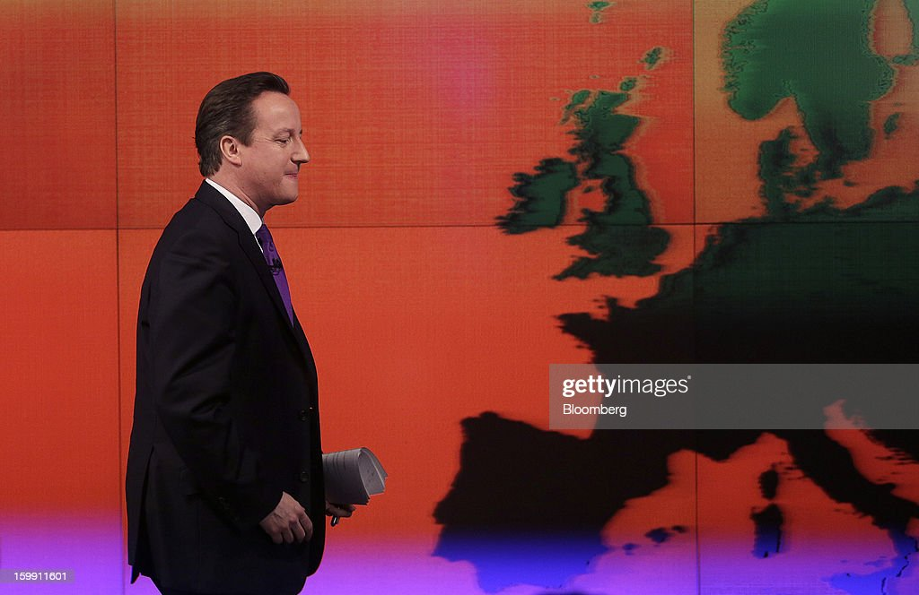 <a gi-track='captionPersonalityLinkClicked' href=/galleries/search?phrase=David+Cameron+-+Politician&family=editorial&specificpeople=227076 ng-click='$event.stopPropagation()'>David Cameron</a>, U.K. prime minister, passes a map of Europe after delivering a speech at the Bloomberg L.P. offices in London, U.K., on Wednesday, Jan. 23, 2013. Cameron pledged an in-out referendum on whether Britain should leave the European Union, allowing U.K. voters to decide on breaking up the 27-nation bloc. Photographer: Matthew Lloyd/Bloomberg via Getty Images