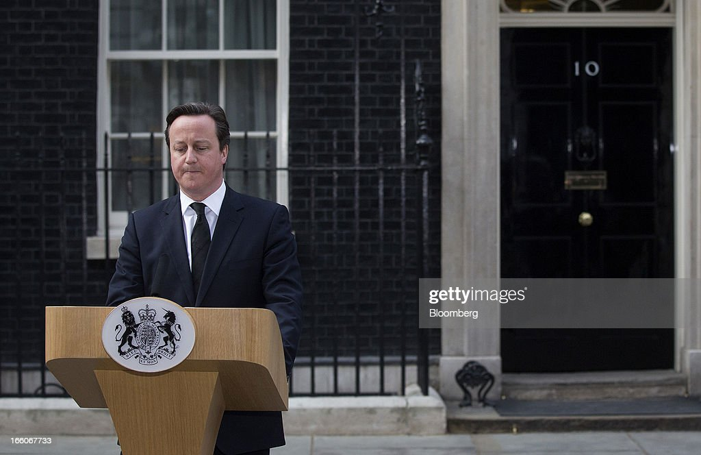 <a gi-track='captionPersonalityLinkClicked' href=/galleries/search?phrase=David+Cameron+-+Politico&family=editorial&specificpeople=227076 ng-click='$event.stopPropagation()'>David Cameron</a>, U.K. prime minister, reads a statement while standing outside number 10 Downing Street following the death of former premier Margaret Thatcher in London, U.K., on Monday, April 8, 2013. Thatcher, the former U.K. prime minister who helped end the Cold War and was known as the 'Iron Lady' for her uncompromising style, died today. She was 87. Photographer: Simon Dawson/Bloomberg via Getty Images