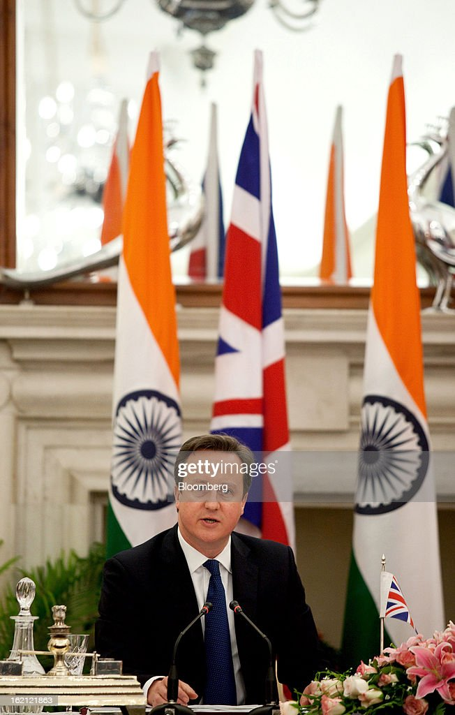 David Cameron, U.K. prime minister, speaks during a news conference with Manmohan Singh, India's prime minister, unseen, at Hyderabad House in New Delhi, India, on Tuesday, Feb. 19, 2013. Cameron said he wants to see rapid progress on a European Union-India free trade agreement as a way of boosting economic growth. Photographer: Graham Crouch/Bloomberg via Getty Images