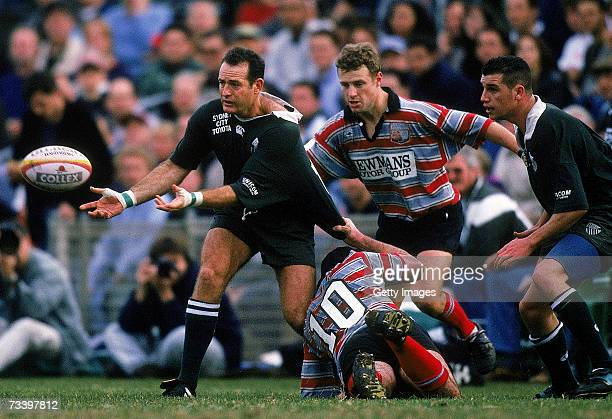 David Campese of Randwick offloads the ball during a club rugby match between Randwick and Southern Districts at Coogee Oval 1998 in Sydney Australia
