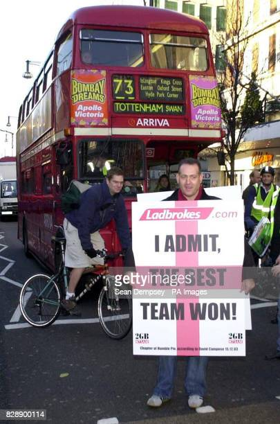 David Campese walks down Oxford street with a banner declaring ' I admit it the best team won the rugby world cup ' on his sandwich board