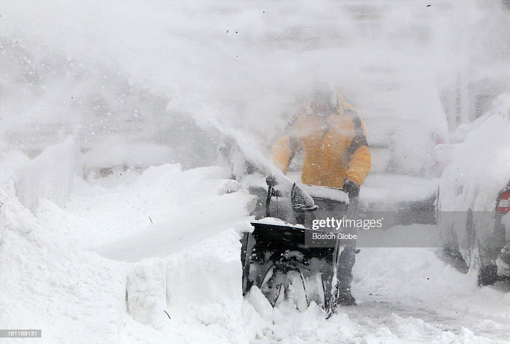 David Cannon, of Marshfield, began the task of clearing his driveway amid wind swept swirling snow that continued to fall at midday.