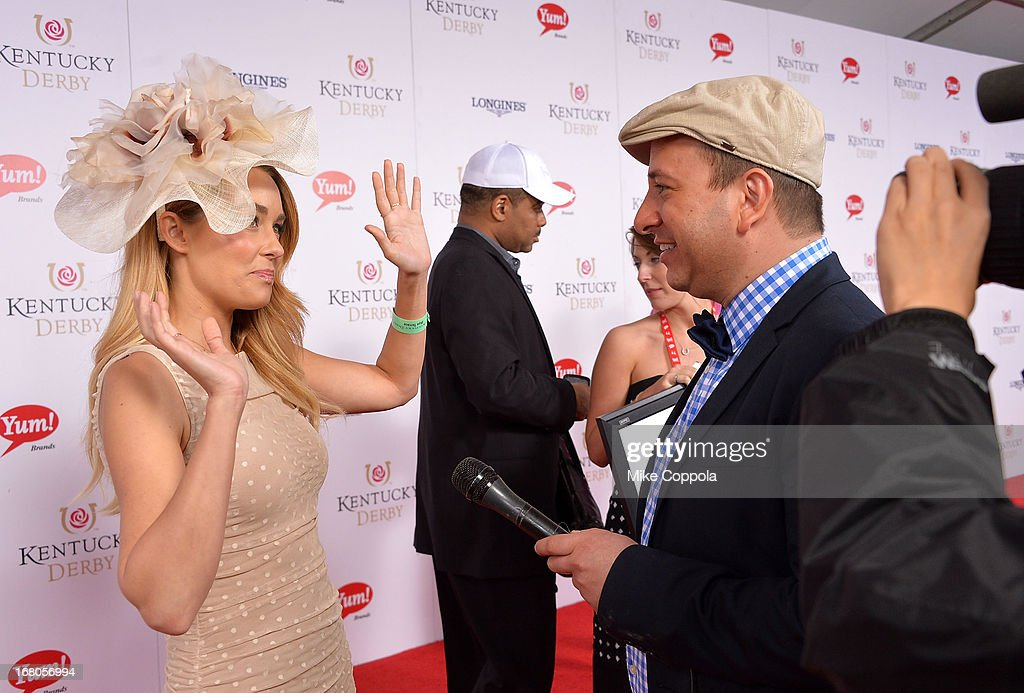 David Caplan, journalist for gossipdavid.com, interviews TV personality Lauren Conrad on the red carpet at the 139th Kentucky Derby at Churchill Downs on May 4, 2013 in Louisville, Kentucky.