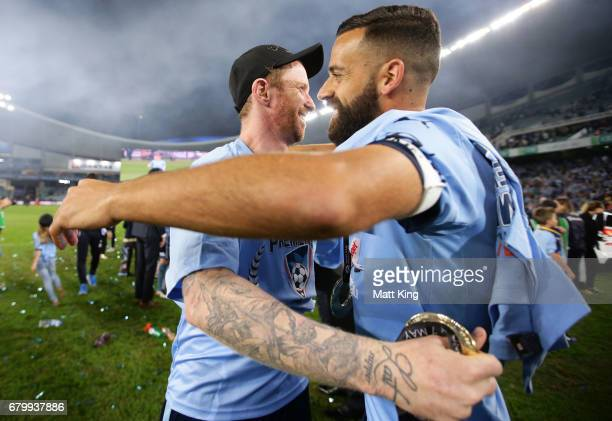 David Carney and Alex Brosque of Sydney FC celebrate victory after the 2017 ALeague Grand Final match between Sydney FC and the Melbourne Victory at...
