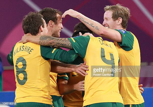 David Carney of Australia celebrates his goal with teammates during the AFC Asian Cup Semi Final match between Uzbekistan and the Australian...