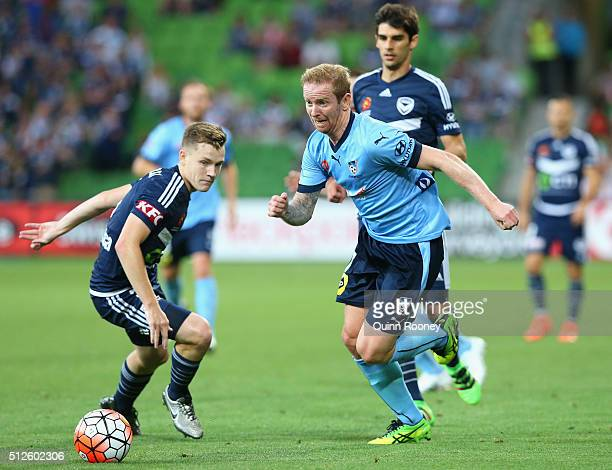 David Carney of Sydney FC gets past Scott Galloway of the Victory during the round 21 ALeague match between Melbourne Victory and Sydney FC at AAMI...