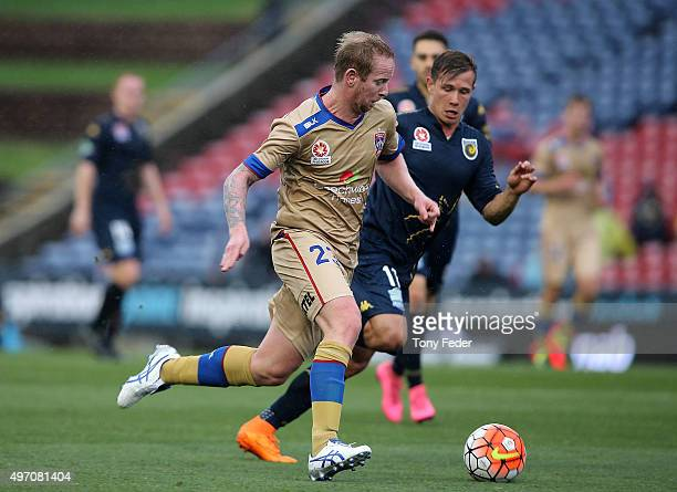 David Carney of the Jets contests the ball with Nick Fitzgerald of the Mariners during the round six ALeague match between the Newcastle Jets and the...