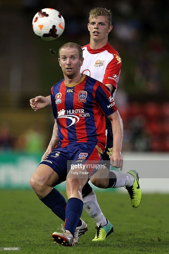 David Carney of the Jets controls the ball in front of Jordan Elsey of Adelaide during the round 27 A-League match between the Newcastle Jets and Adelaide United at Hunter Stadium on April 11, 2014 in Newcastle, Australia.