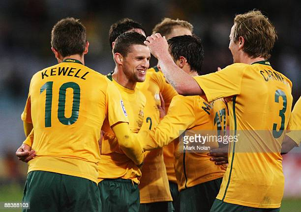 David Carney of the Socceroos is congratulated by teammates after scoring during the 2010 FIFA World Cup Asian qualifying match between the...