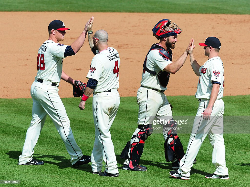 David Carpenter #48, Ryan Doumit #4, Evan Gattis #24, and Tyler Pastornicky #1 of the Atlanta Braves (L-R) celebrate after the game against the Chicago Cubs at Turner Field on May 11, 2014 in Atlanta, Georgia.