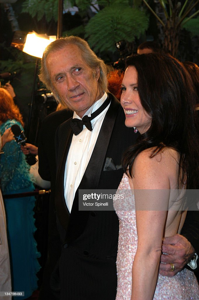 <a gi-track='captionPersonalityLinkClicked' href=/galleries/search?phrase=David+Carradine&family=editorial&specificpeople=171315 ng-click='$event.stopPropagation()'>David Carradine</a> and <a gi-track='captionPersonalityLinkClicked' href=/galleries/search?phrase=Annie+Bierman&family=editorial&specificpeople=211592 ng-click='$event.stopPropagation()'>Annie Bierman</a> during 14th Annual Night of 100 Stars Oscar Gala at Beverly Hills Hotel in Beverly Hills, California, United States.