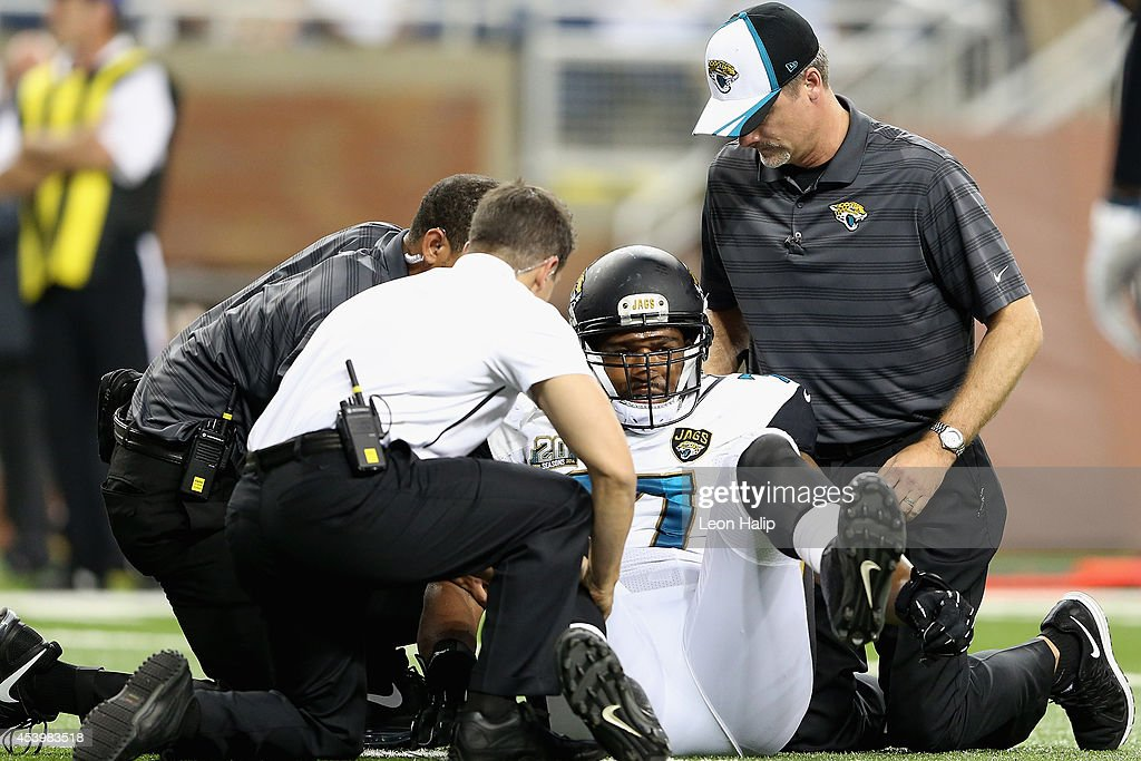 David Carter #77 of the Jacksonville Jaguars is injured during the fourth quarter while playing the Detroit Lions during a preseason game at Ford Field on August 22, 2014 in Detroit, Michigan.
