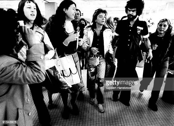 David Cassidy walks through a crowd of fans at Schiphol Airport Amsterdam Holland in 1975