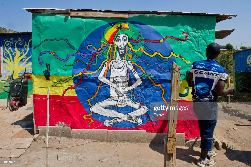 David Chauke stands outside of one the painted shacks at the Alaska Informal settlement on March 24, 2013 in Mamelodi, South Africa. The Viva Foundation hosted the second Mams Art Festival at the informal settlement over the weekend. The art festival focuses on creating the world's first living art gallery by transforming shacks into art work.