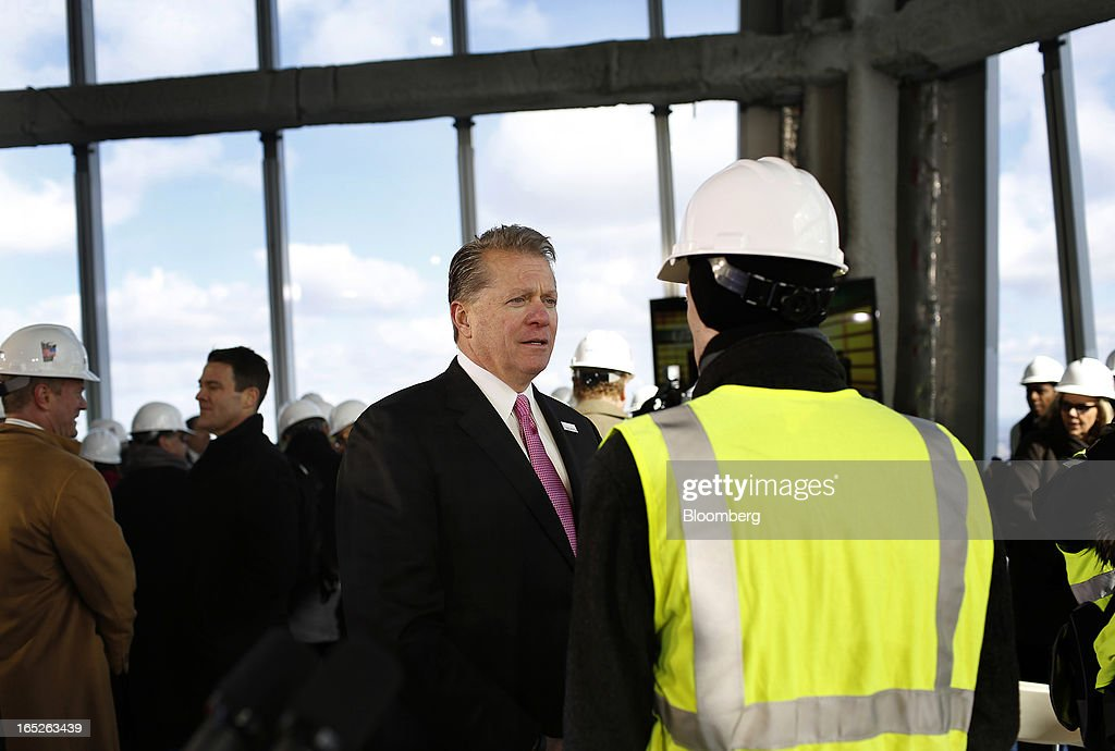 David Checketts, Chairman and chief executive officer of Legends Hospitality Management LLC, left, speaks to an attendee during a media tour of the One World Trade Center observation deck in New York, U.S., on Tuesday, April 2, 2013. The observation deck at One World Trade Center, expected to open in 2015, will occupy the tower's 100th through 102nd floors. Guests visiting the observation deck will see a 'pre-show' about the creation of the building while waiting in line in the lobby. Photographer: Victor J. Blue/Bloomberg via Getty Images