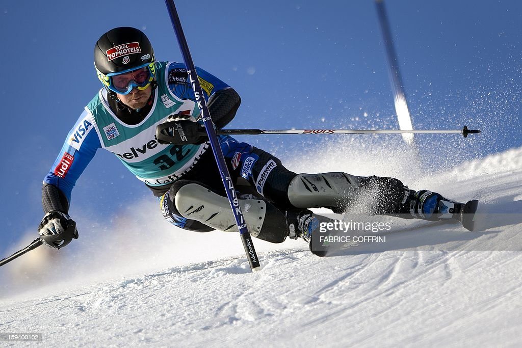 US' David Chodounsky clears a gate on January 13, 2013 to placed 10th in the men's giant slalom race of the FIS Alpine Skiing World Cup in Adelboden.