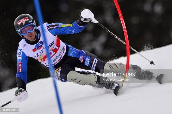 David Chodounsky of the US misses a gate during the Men Slalom race at the Alpine ski World Cup finals on March 17 2013 in Lenzerheide AFP PHOTO /...
