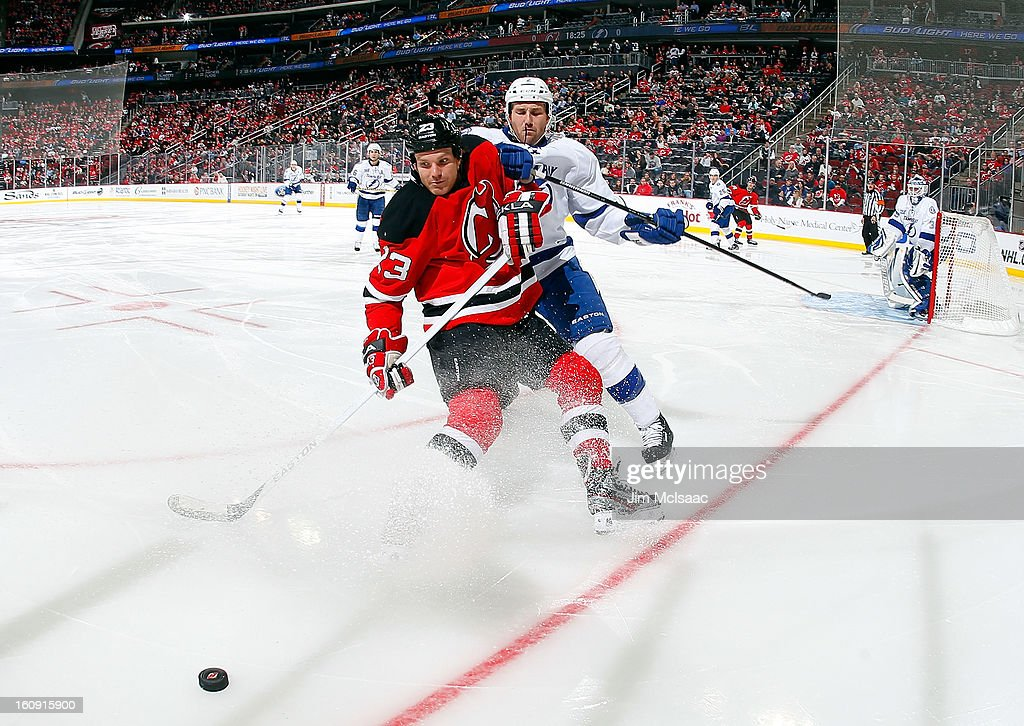David Clarkson #23 of the New Jersey Devils battles for the puck against <a gi-track='captionPersonalityLinkClicked' href=/galleries/search?phrase=Eric+Brewer&family=editorial&specificpeople=202144 ng-click='$event.stopPropagation()'>Eric Brewer</a> #2 of the Tampa Bay Lightning at the Prudential Center on February 7, 2013 in Newark, New Jersey.