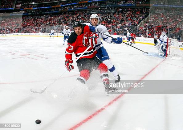 David Clarkson of the New Jersey Devils battles for the puck against Eric Brewer of the Tampa Bay Lightning at the Prudential Center on February 7...