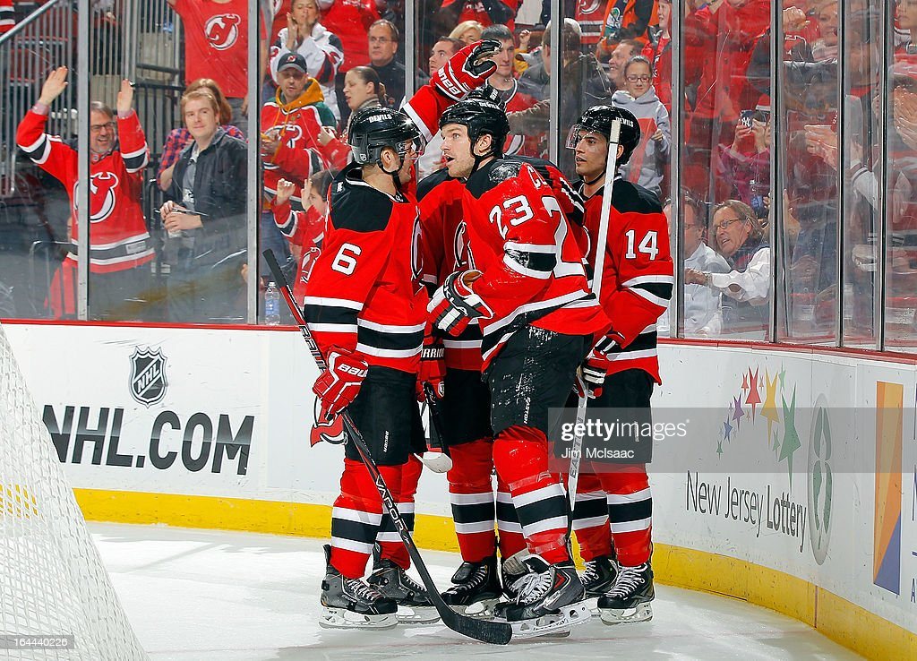 David Clarkson #23 of the New Jersey Devils celebrates his second period goal against the Florida Panthers with teammates Andy Greene #6 and Adam Henrique #14 at the Prudential Center on March 23, 2013 in Newark, New Jersey.
