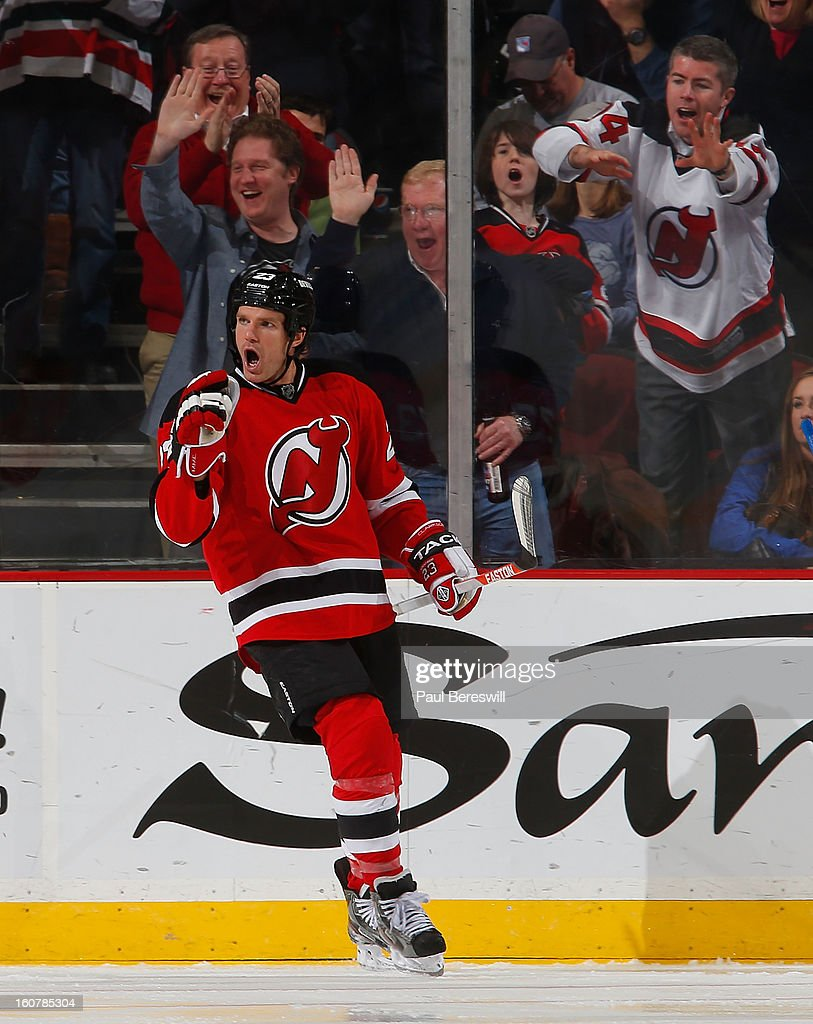 David Clarkson #23 of the New Jersey Devils celebrates scoring a goal during the third period of an NHL hockey game against the New York Rangers at Prudential Center on February 5, 2013 in Newark, New Jersey.