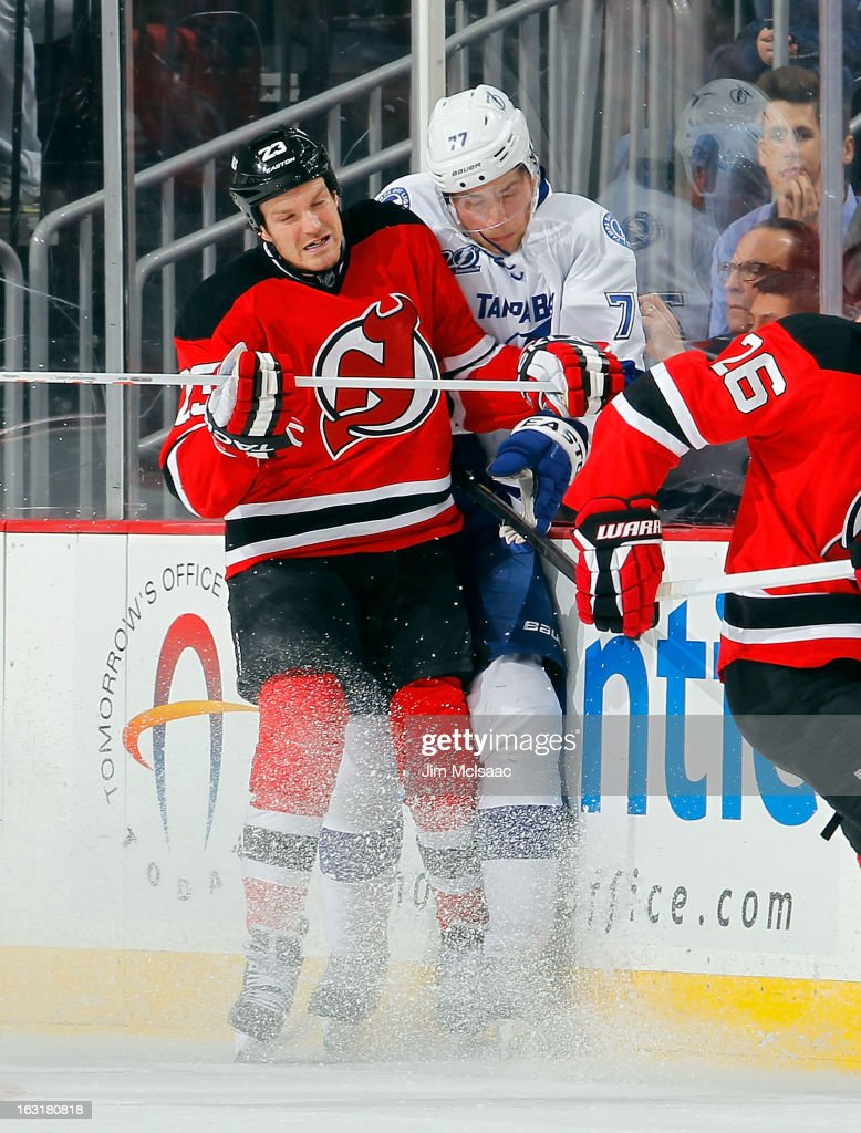 David Clarkson #23 of the New Jersey Devils checks <a gi-track='captionPersonalityLinkClicked' href=/galleries/search?phrase=Victor+Hedman&family=editorial&specificpeople=4784238 ng-click='$event.stopPropagation()'>Victor Hedman</a> #77 of the Tampa Bay Lightning at the Prudential Center on March 5, 2013 in Newark, New Jersey.