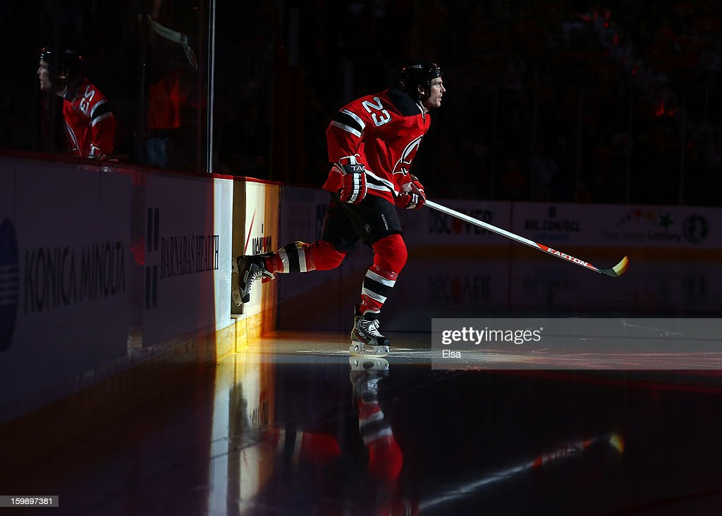 David Clarkson #23 of the New Jersey Devils heads onto the ice for player introductions before the game against the Philadelphia Flyers during the season opener at the Prudential Center on January 22, 2013 in Newark, New Jersey.