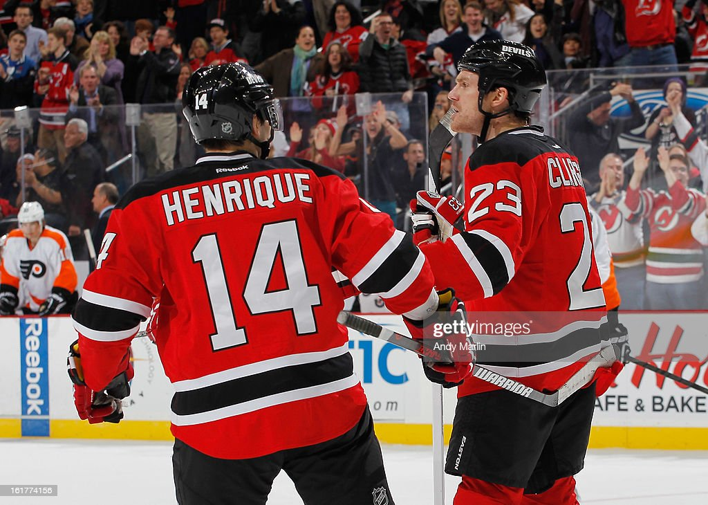 David Clarkson #23 of the New Jersey Devils is congratulated by teammate Adam Henrique #14 after Clarkson scored the game winning goal against the Philadelphia Flyers during the game at the Prudential Center on February 15, 2013 in Newark, New Jersey. The Devils defeated the Flyers 5-3.