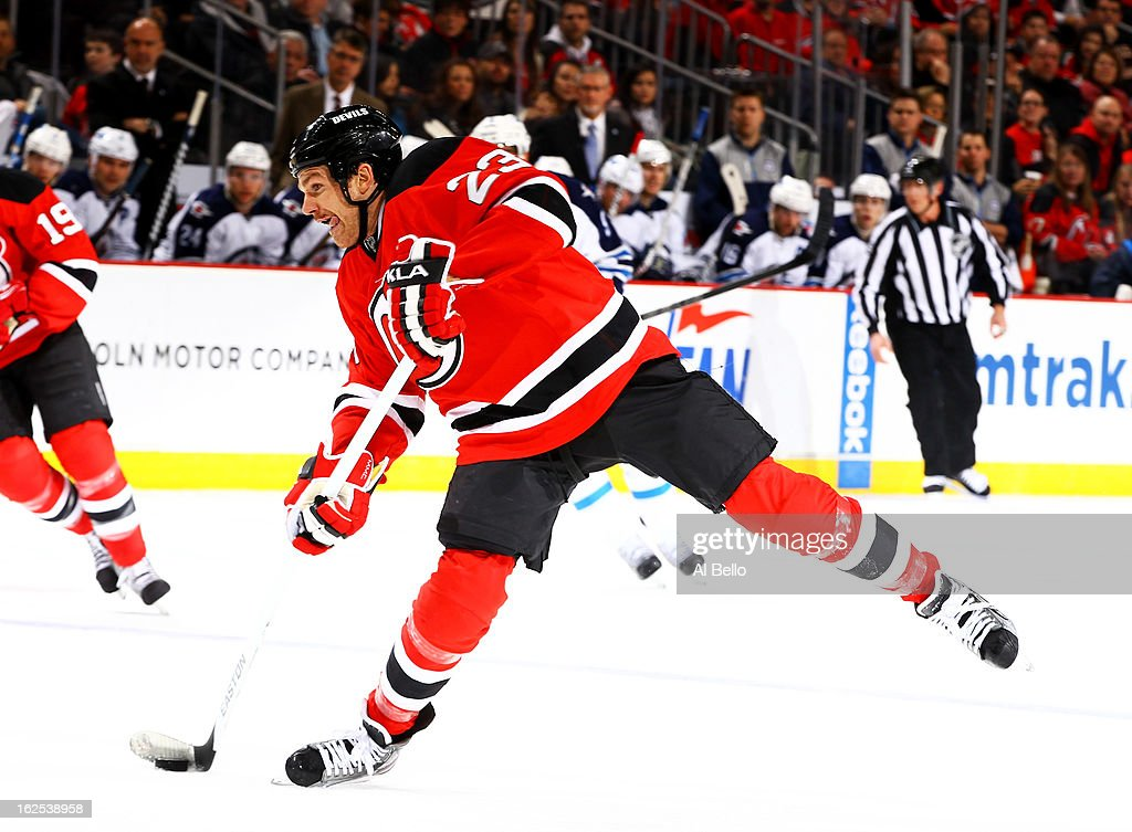 David Clarkson #23 of the New Jersey Devils shoots against the Winnipeg Jets during their game at the Prudential Center on February 24, 2013 in Newark, New Jersey.