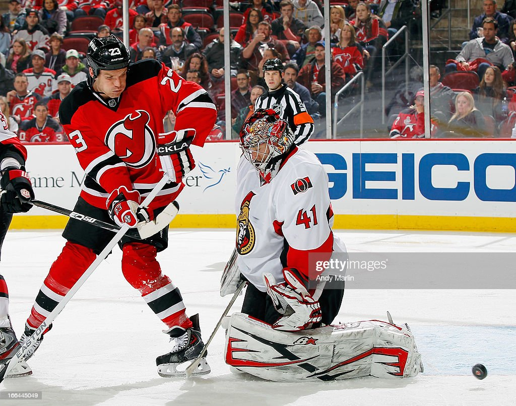 David Clarkson of the New Jersey Devils shoots the puck past Craig Anderson of the Ottawa Senators for a secondperiod goal during the game at the...