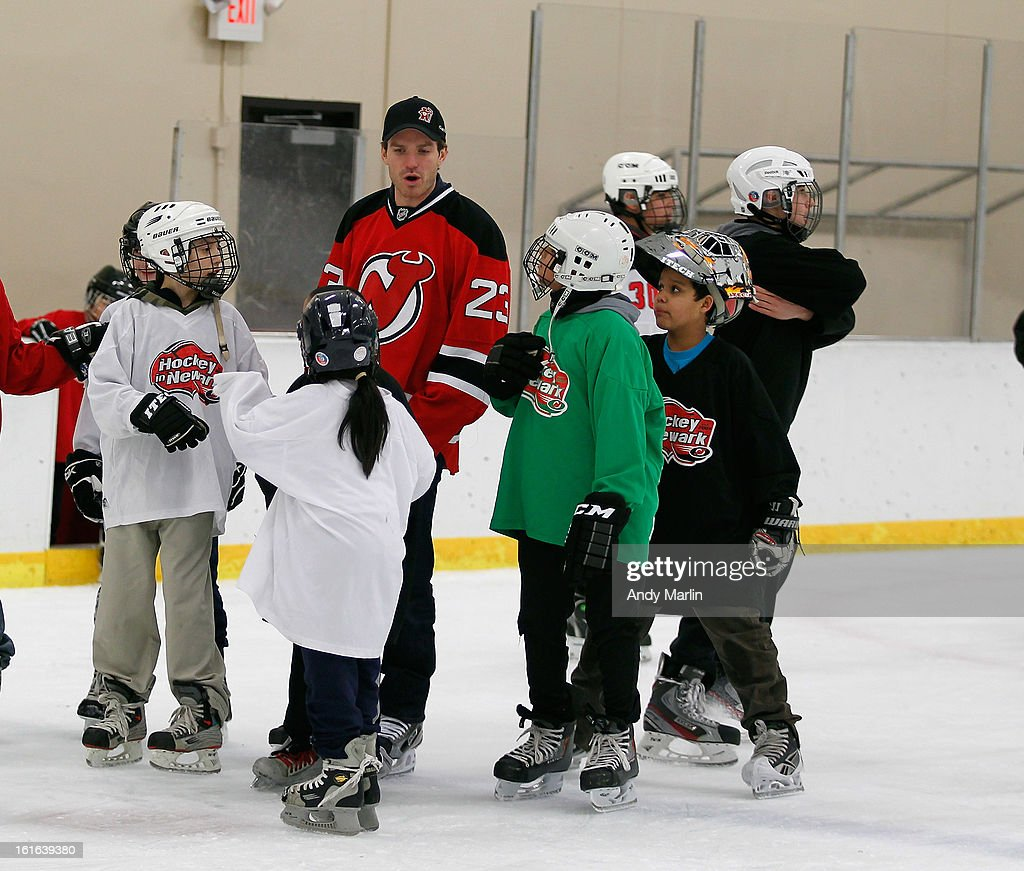 David Clarkson of the New Jersey Devils skates with the kids during the Hockey in Newark instructional clinic during on February 13, 2013 in Newark, New Jersey.
