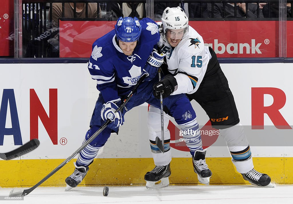 David Clarkson #71 of the Toronto Maple Leafs battles for the puck with <a gi-track='captionPersonalityLinkClicked' href=/galleries/search?phrase=James+Sheppard&family=editorial&specificpeople=537966 ng-click='$event.stopPropagation()'>James Sheppard</a> #15 of the San Jose Sharks during NHL game action December 3, 2013 at the Air Canada Centre in Toronto, Ontario, Canada.