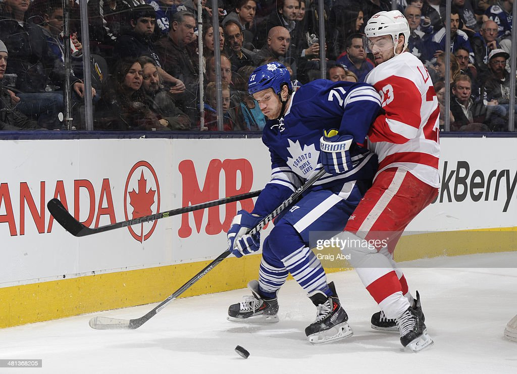 David Clarkson #71 of the Toronto Maple Leafs battles for the puck with Brian Lashoff #23 of the Detroit Red Wings during NHL game action March 29, 2014 at the Air Canada Centre in Toronto, Ontario, Canada.