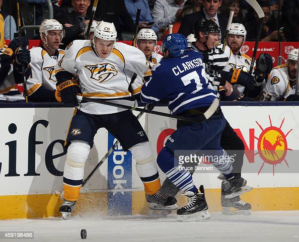 David Clarkson of the Toronto Maple Leafs checks Anton Volchenkov of the Nashville Predators into the boards during the first period at the Air...