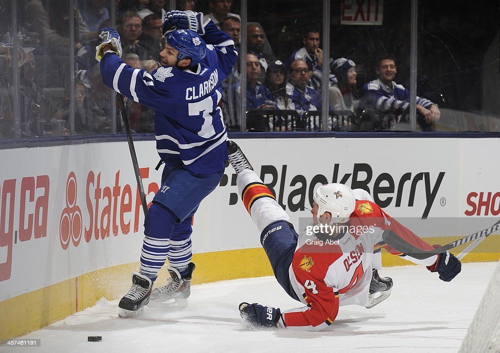 David Clarkson #71 of the Toronto Maple Leafs checks <a gi-track='captionPersonalityLinkClicked' href=/galleries/search?phrase=Dylan+Olsen&family=editorial&specificpeople=5894613 ng-click='$event.stopPropagation()'>Dylan Olsen</a> #4 of the Florida Panthers during NHL game action December 17, 2013 at the Air Canada Centre in Toronto, Ontario, Canada.