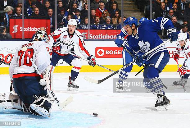 David Clarkson of the Toronto Maple Leafs gets stopped by Braden Holtby of the Washington Capitals during game action on January 7 2015 at Air Canada...