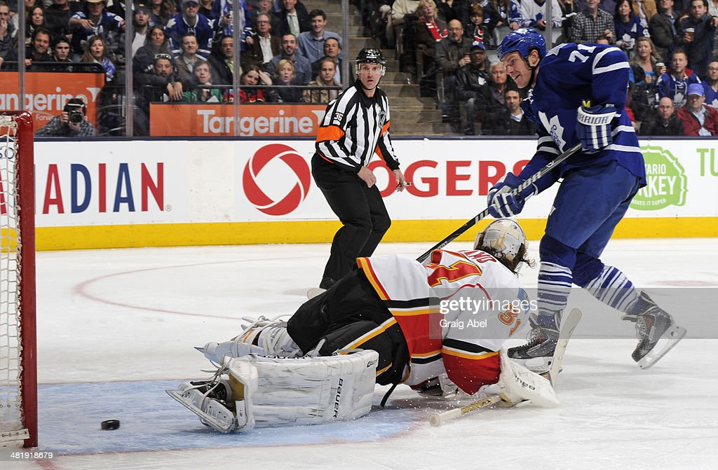 David Clarkson #71 of the Toronto Maple Leafs scores a third period goal on <a gi-track='captionPersonalityLinkClicked' href=/galleries/search?phrase=Karri+Ramo&family=editorial&specificpeople=716721 ng-click='$event.stopPropagation()'>Karri Ramo</a> #31 of the Calgary Flames during NHL game action April 1, 2014 at the Air Canada Centre in Toronto, Ontario, Canada.