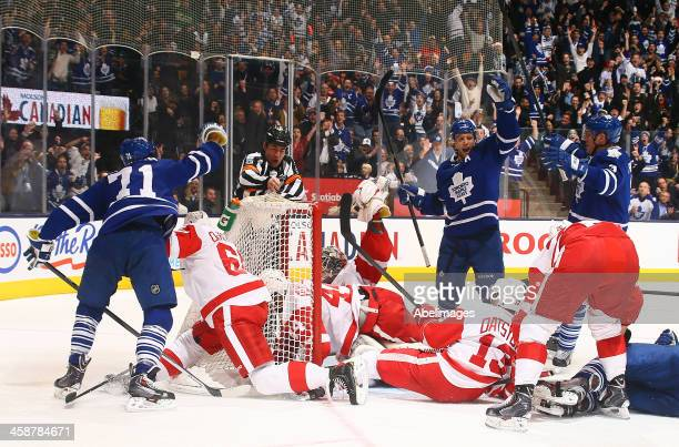 David Clarkson of the Toronto Maple Leafs scores his 100th NHL goal against the Detroit Red Wings during NHL action at the Air Canada Centre December...