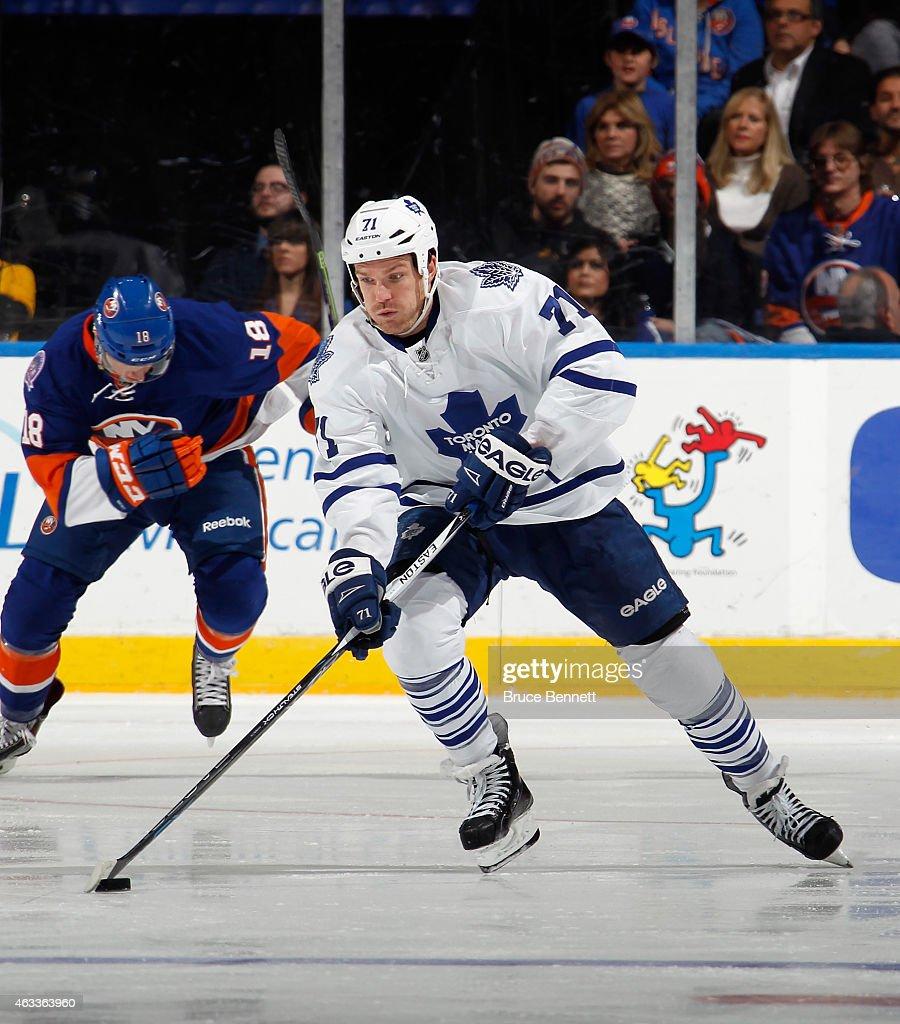 David Clarkson of the Toronto Maple Leafs skates against the New York Islanders at the Nassau Veterans Memorial Coliseum on February 12 2015 in...