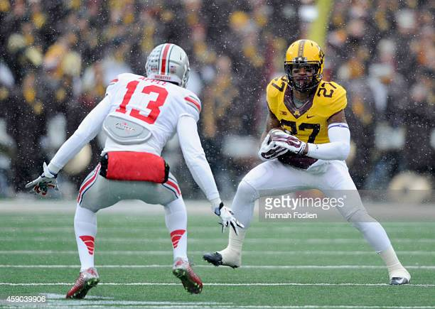 David Cobb of the Minnesota Golden Gophers carries the football against Eli Apple of the Ohio State Buckeyes during the first quarter of the game on...