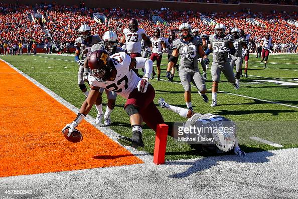 David Cobb of the Minnesota Golden Gophers dives into the end zone for a touchdown as Zane Petty of the Illinois Fighting Illini fails to make the...