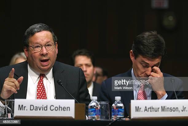 David Cohen executive vice president of the Comcast Corporationtestifies while Arthur Minson Jr executive vice president and CFO of the Time Warner...