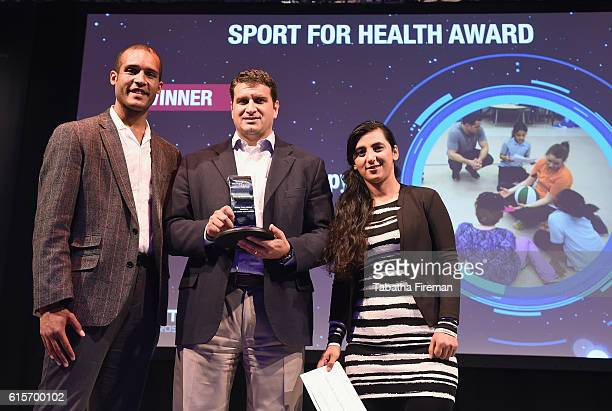 David Cohen of Chalk Talk Group Therapy Doc Wayne Youth Services collects the Sport for Health award presented by Clarke Carlisle during the Beyond...