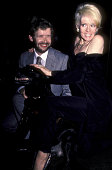 David Cole and actress Joey Heatherton attend Love Leads The Way Seeing Eye Benefit Party on September 24 1984 at the Rainbow Room in New York City